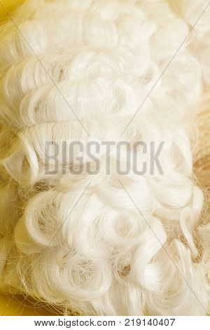 Judge white wig on a yellow background.
