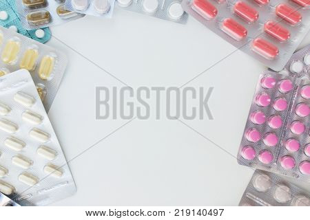 medicine, healthcare and pharmacy concept - different pills and capsules of drugs
