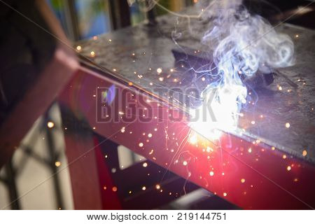 The electric welding process.The sparking light from the arc welding process