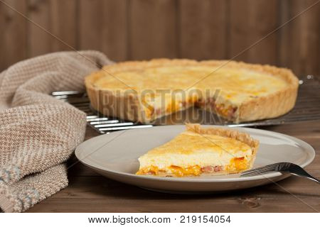 Homebaked Quiche Lorraine With Red Leicester Cheese. Traditional British Food