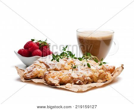 homemade fresh almond croissant with cup of cappuccino isolated on white