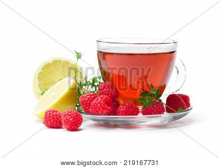 Red fruit tea with lemon and raspberry isolated on white background
