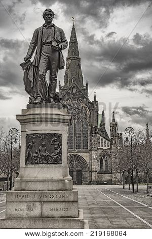 The majestic statue of David Livingstone in front of the main entrance to the magnificent Glasgow cathedral in Scotland.
