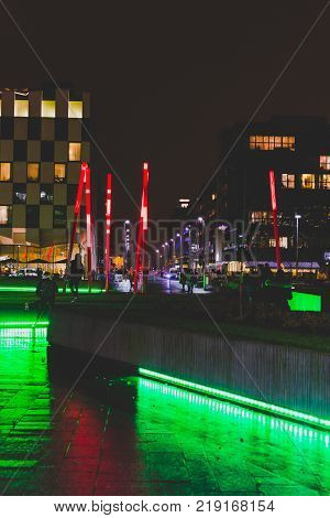 DUBLIN IRELAND - December 20th 2017: Grand Canal Square by night in the renovated Docklands area