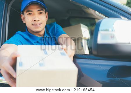 Delivery driver offering parcel to customer. Delivery service.