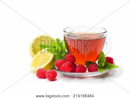 Red fruit tea with raspberry and mint isolated on white background