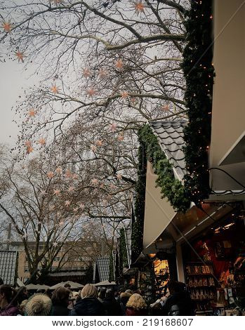 Cologne, Germany - December 17, 2017: German Christmas Market. Shoppers visit vendors selling gifts, wine and gourmet food at the annual Cologne Angel Christmas market.
