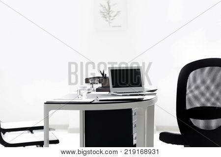 Workplace of notary with laptop in office