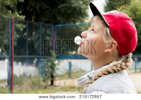 Teen Girl and Chewing Gum in the Sity