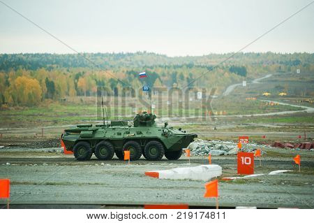 Nizhniy Tagil, Russia - September 25. 2013: BTR-82A armoured personnel carrier moves on shooting demonstration range. RAE-2013 exhibition