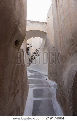 Narrow street in traditional Cycladic style Emporio village, Santorini