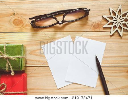 Papers and pen for writing New Year's Resolutions. New Year Goals concept.