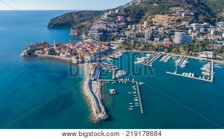 Old Town Budva with Morgen beach, Aerial view from sky. Montenegro
