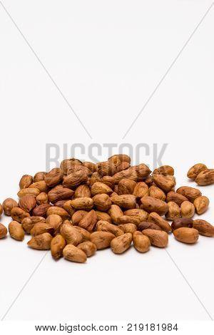 pile of pealed hazelnuts on the white background