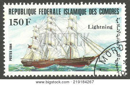 Kiev, Ukraine, December 22, 2017 - Stamp printed by Comoros Color memorable offset Edition Shows Sailing ship Lightning on water, CIRCA 1984