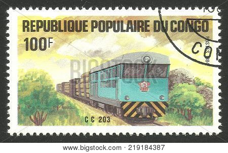 Kiev, Ukraine, December 22, 2017: Stamp printed by Congo Color memorable edition offset printing on the topic of Railway shows Cargo train and Locomotive CIRCA 1984