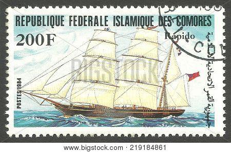 Comoros - CIRCA 1984: stamp printed by Comoros Color memorable Edition offset printing Shows Sailing ship Rapido  on water