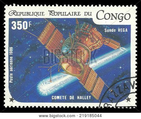 Kiev, Ukraine, December 22, 2017: Stamp printed by Congo Color memorable Air mail edition offset printing on topic  devoted Halley Comet shows Sonde Vega in the Space, CIRCA 1986
