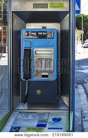 Spain Blanes - 09/20/2012: Booth with payphone for city and long-distance calls