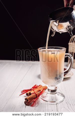 Hot Green Tea With Cinnamon On White Background
