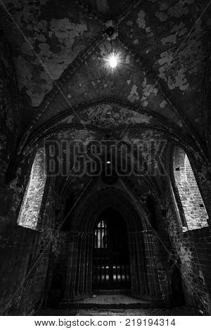 CHORIN GERMANY - OCTOBER 02 2017: An old unrestored part of Chorin Abbey. Cistercian abbey near the village of Chorin in Brandenburg. Founded in 1258. Black and white.