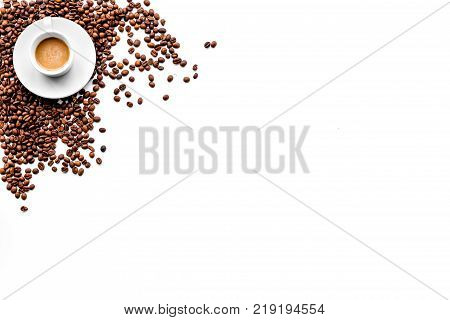 Cup of freshly brewed full-bodied coffee on white table top view copyspace. Coffee background