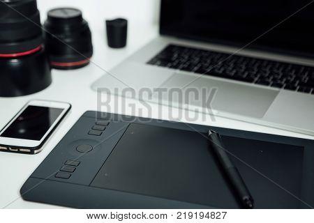 Workspace of professional retoucher. laptop, stylus and tablet for retouching. Workspace of professional retoucher.