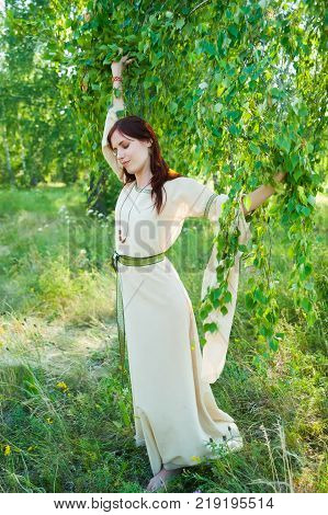 Attractive Woman with Wreath of Flowers. Ivan Kupala Holiday Celebration