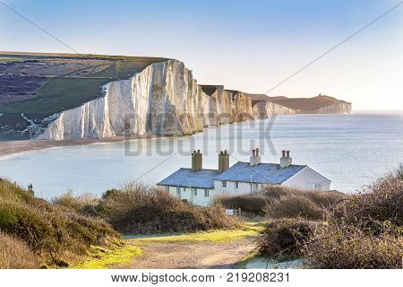 The Coast Guard Cottages and Seven Sisters Chalk Cliffs just outside Eastbourne, Sussex, England, UK