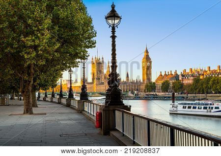 Street Lamp on South Bank of River Thames with Big Ben and Palace of Westminster in Background, London, England, UK.