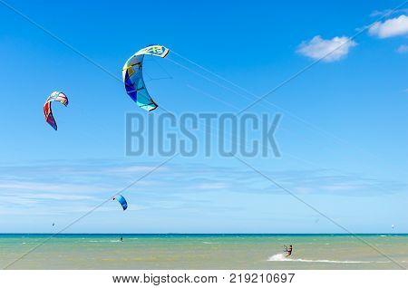 Multiple Sports Man Flying On Their Kite Boarding