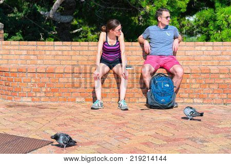 Capri Italy - October 3 2017: Tourists having a break while sitting on the bench on Capri Island Italy
