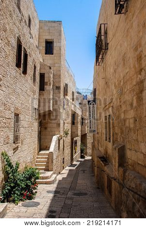 JERUSALEM ISRAEL - AUGUST 03 2010: Vertical picture of narrow street at Jewish Quarter inside the walls of Old City in Jerusalem Israel