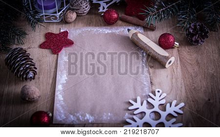 greeting card and pencil in the Christmas background.photo with copy space