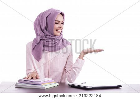 portrait of beautiful college student wearing hijab presenting copy space isolated on white backgorund