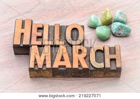 Hello March in vintage letterpress wood type with green gemstone crystals