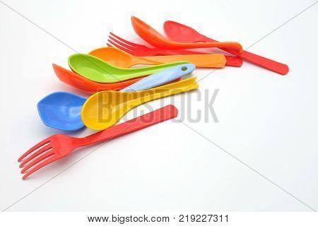 set of plastic utensils on white brackground.utensils isolated.