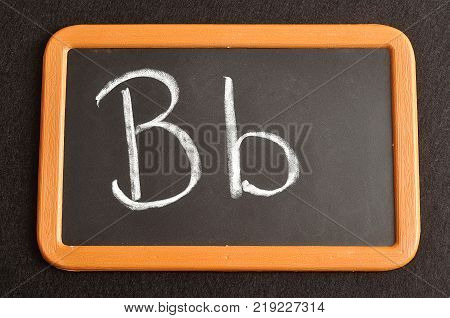 A black board with the alphabet letter B in a capital and small letter