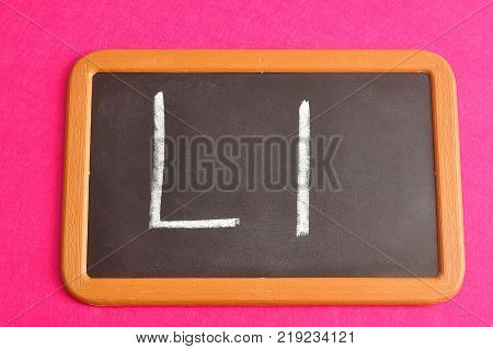 A black board with the alphabet letter L in a capital and small letter