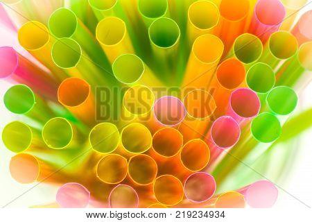 Macro view of multi coloured drinking straws