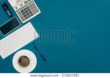 top view of alarm clock calculator contract with pens credit card and laptop on white