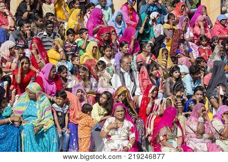 JAISALMER INDIA - FEBRUARY 08 2017 : Crowd of Indian spectators on a tribune at a Desert Festival in Jaisalmer Rajasthan India