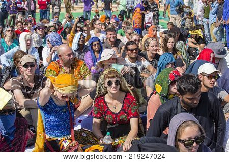 JAISALMER INDIA - FEBRUARY 08 2017 : Crowd of european spectators on a tribune at a Desert Festival in Jaisalmer Rajasthan India