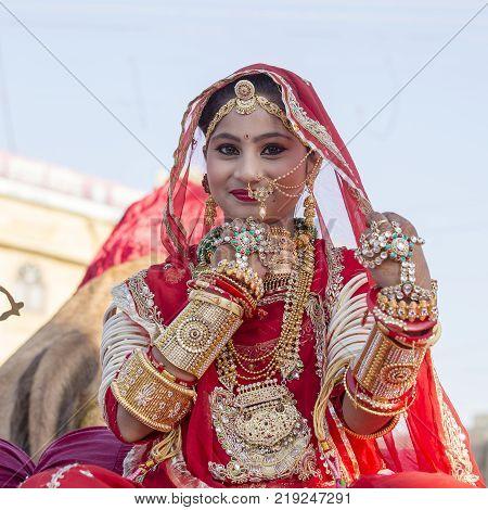 JAISALMER INDIA - FEBRUARY 08 2017 : Indian girl wearing traditional Rajasthani dress participate in Desert Festival in Jaisalmer Rajasthan India
