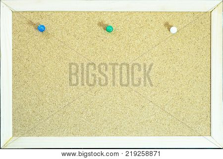Colorful pins on cork board for memo or education