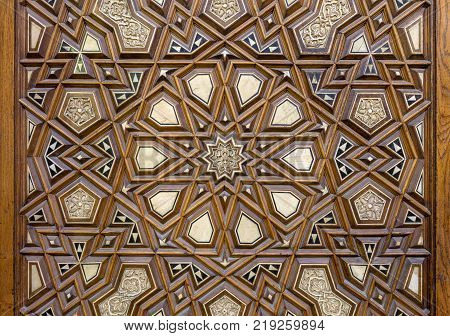 Closeup of arabesque ornaments of an old aged decorated wooden door Old Cairo Egypt