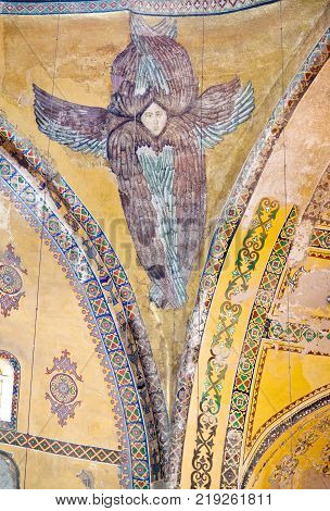 ISTANBUL, TURKEY - OCTOBER 30, 2015: Interior of Hagia Sophia Dome with fresco of Hexapterygon - six-winged Seraphim, biblical angel. Structure was formerly basilica, mosque, and now museum