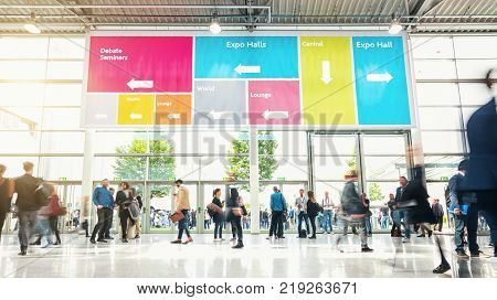 business people walking at a modern hall on a tradeshow. ideal for websites and magazines layouts