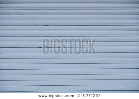 The texture of white horizontal plastic pannels, background