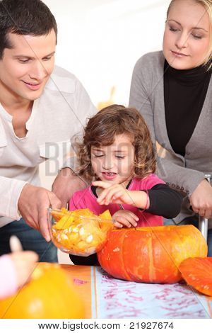 Family carving hallowe'en pumpkin